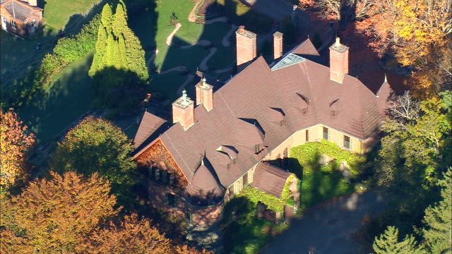 ms aerial zi ds shot of red house surrounded by tree at naumkeag estate / massachusetts, united states - 50 seconds or greater stock videos & royalty-free footage