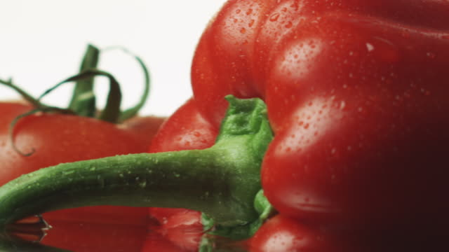 ecu pan slo mo shot of red pepper / toronto, ontario, canada  - red bell pepper stock videos & royalty-free footage