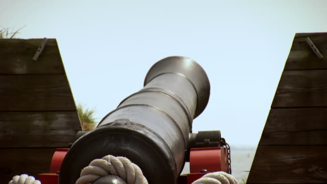ms shot of reenactment american soldiers pour gunpowder and fire cannon / baltimore, maryland, united states  - gunpowder explosive material stock videos & royalty-free footage