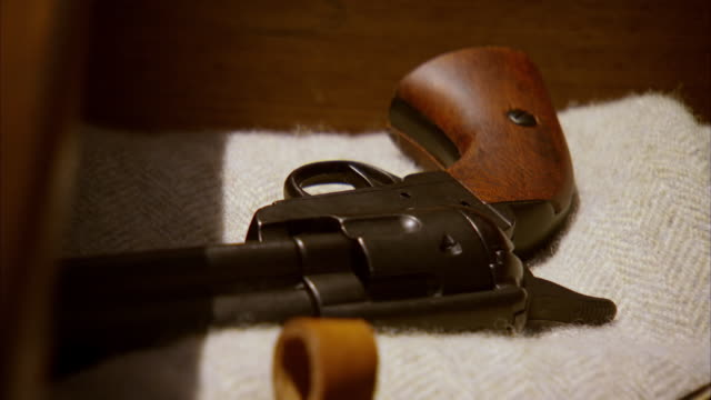 CU Shot of REENACTMENT dresser drawer opened and pistol is taken out / United States