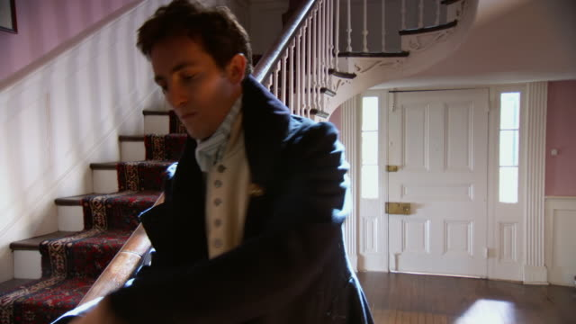 ms tu td shot of reenactment francis scott key putting on coat and hat and leaving house through door / alexandria, virginia, united states  - coat garment stock videos and b-roll footage