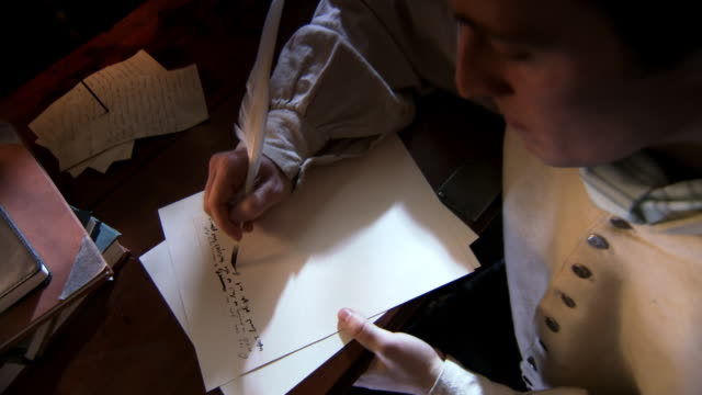 CU Shot of Reenactment Francis Scott Keys hands writing a draft of Star Spangled Banner lyrics / Alexandria, Virginia, United States