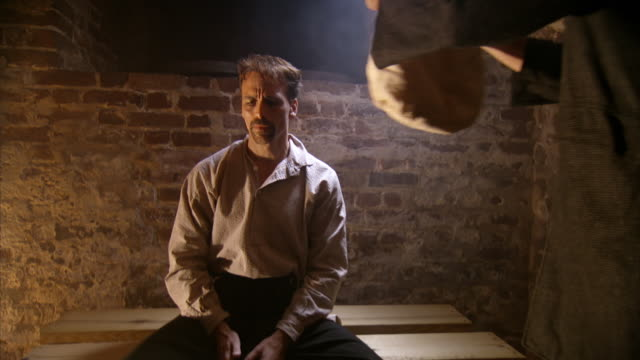 ms zi shot of reenactment george atzerodt in his prison cell, prison hood being put on / united states  - bürgerkrieg stock-videos und b-roll-filmmaterial