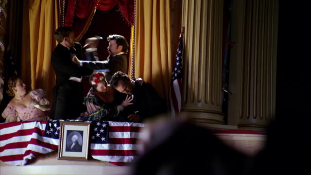 MS Shot of REENACTMENT John Wilkes Booth stabs Henry Rathbone with President Abraham Lincoln struggling for his life at Fords Theatre / United States