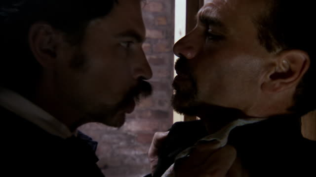 CU Shot of REENACTMENT John Wilkes Booth talks with George Atzerodt and threatens him / United States