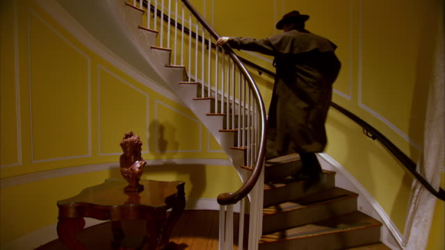 MS Shot of REENACTMENT Lewis Powell runs up stairs / United States