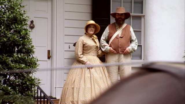 ms shot of reenactment man and woman watch president abraham lincoln and mary todd lincoln riding in horse drawn carriage / united states - animal markings stock videos & royalty-free footage
