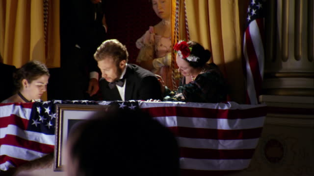 ms shot of reenactment mary todd lincoln and dr. charles leale and clara harris tending to shot president abraham lincoln in box seat at fords theatre / united states - abraham lincoln stock videos & royalty-free footage