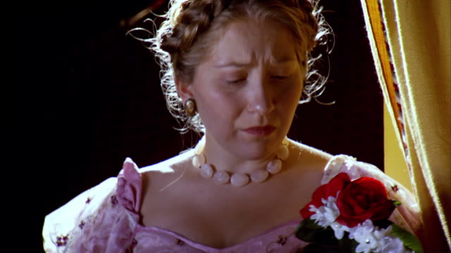 CU TU Shot of REENACTMENT Mary Todd Lincoln crying on Clara Harris immediately after shooting of President Abraham Lincoln at Fords Theatre / United States