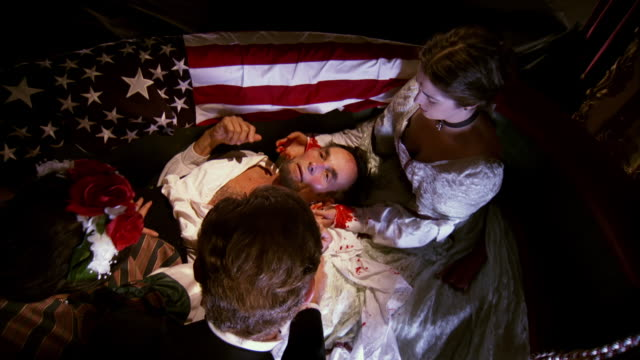 MS HA Shot of REENACTMENT overhead President Abraham Lincoln on floor after being shot by John Wilkes Booth and Mary Todd Lincoln and others surrounding him at Fords Theatre / United States