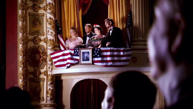 MS R/F Shot of REENACTMENT  President Abraham Lincoln and Mary Todd Lincoln and Henry Rathbone and Clara Harris in box seat at Fords Theatre / United States