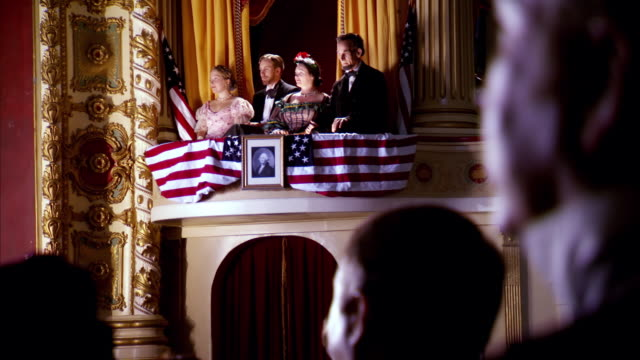 MS TU Shot of REENACTMENT President Abraham Lincoln and Mary Todd Lincoln and Henry Rathbone and Clara Harris in box seat at Fords Theatre / United States