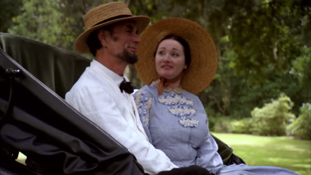 ms pov shot of reenactment president abraham lincoln and mary todd lincoln talking while riding in horse drawn carriage / united states - cocchio video stock e b–roll