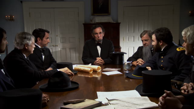 ms zi shot of reenactment president abraham lincoln meeting with cabinet members / united states  - エイブラハム・リンカーン点の映像素材/bロール