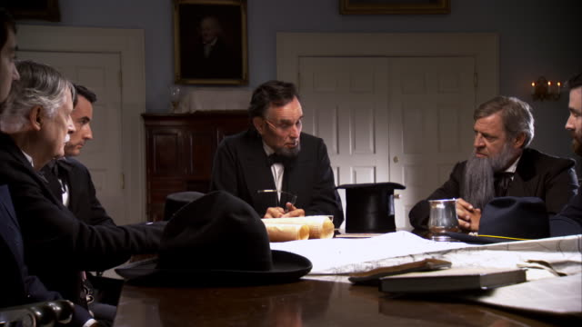 MS PAN Shot of REENACTMENT President Abraham Lincoln speaking to cabinet / United States