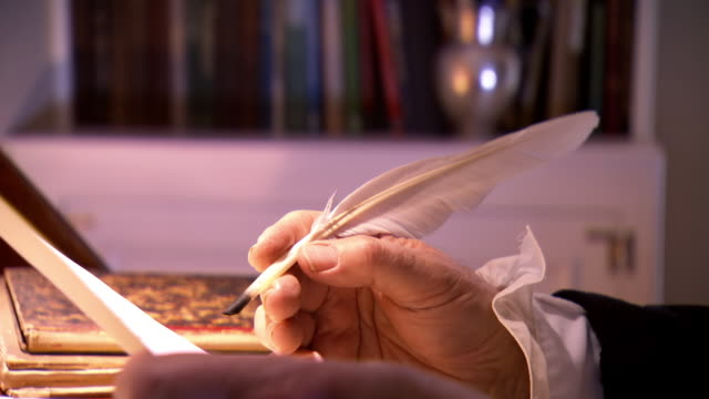 ms pan shot of reenactment president james madison writing a letter using quill / baltimore, maryland, united states  - ジェームズ・マディソン点の映像素材/bロール