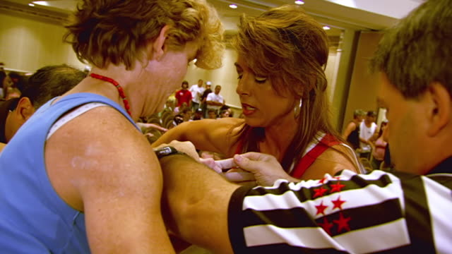 ms zo zi shot of referee arranging hands of two women contestants at start of match during us arm wrestling federation national championships / kansas city, missouri, united states - arm wrestling stock videos & royalty-free footage