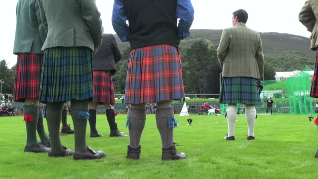 ms shot of referees standing and man throwing hammer at braemar royal highland games / braemar, aberdeenshire, scotland - highland games stock videos & royalty-free footage