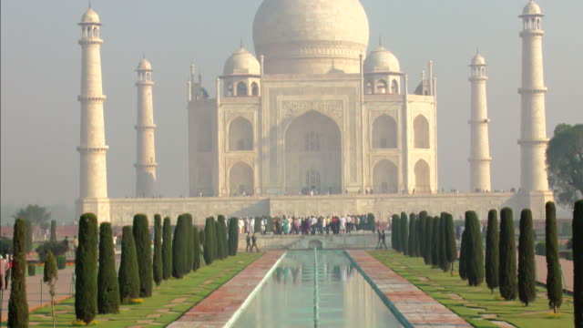 ms tu shot of reflecting pool to taj mahal against blue sky / agra, uttar pradesh, india - taj mahal stock videos and b-roll footage