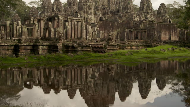 MS TU Shot of reflection of Angor Wat Temple in river with soft rain falling on water / Siem Reap, Siem Reap Province, Cambodia