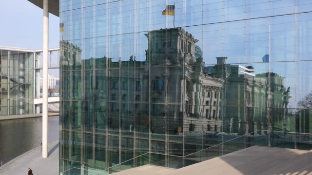 ms shot of reflection of reichstag in marie elisabeth lì_ders haus / berlin, germany - the reichstag stock videos & royalty-free footage