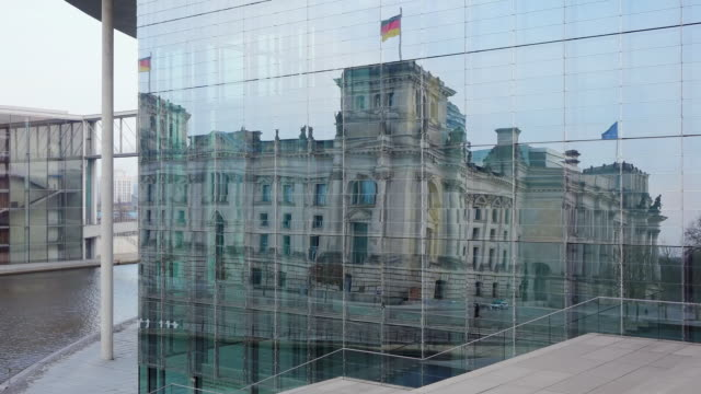 ms shot of reflection of reichstag in marie elisabethluders haus / berlin, germany - the reichstag stock videos & royalty-free footage