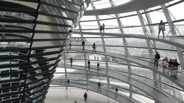ms shot of reichstag building and people walking in glass dome / berlin, germany - government building stock videos and b-roll footage