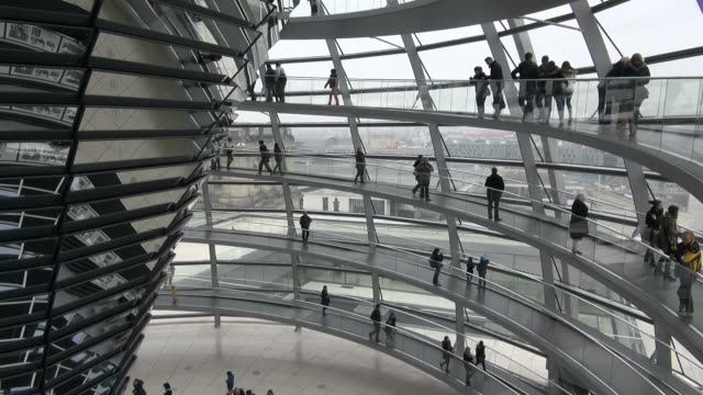 ms pan shot of reichstag building and people walking in glass dome / berlin, germany - cupola video stock e b–roll