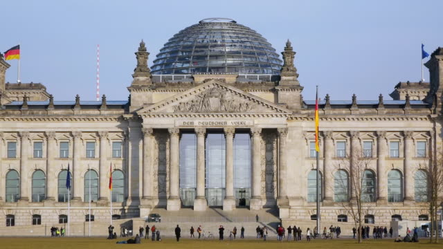 ms shot of reichstag building with people walking / berlin, germany - kuppeldach oder kuppel stock-videos und b-roll-filmmaterial