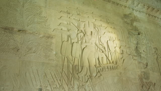 ms shot of relief carving in wall along outside corridor in angkor wat temple / siem reap, siem reap province, cambodia - relief carving stock videos & royalty-free footage