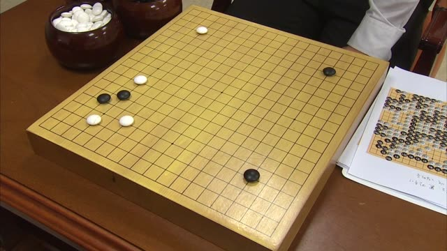 Shot of replaying Go board Game(A Popular Korean board Game, It is also called Weiqi in Chinese, Igo in Japanese, and Baduk in Korean) using game record