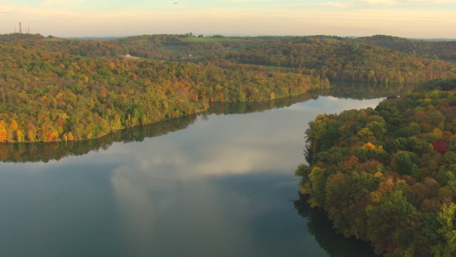 stockvideo's en b-roll-footage met ws aerial shot of reservoir in washington county and sky clouds reflected in water / pennsylvania, united states - pennsylvania