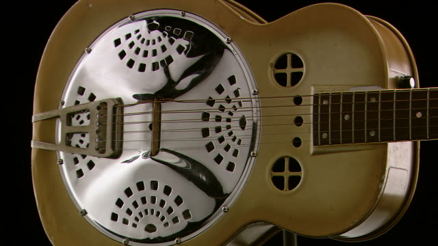 ms shot of resonator guitar on turntable / nashville, tennessee, united states - banjo stock videos & royalty-free footage