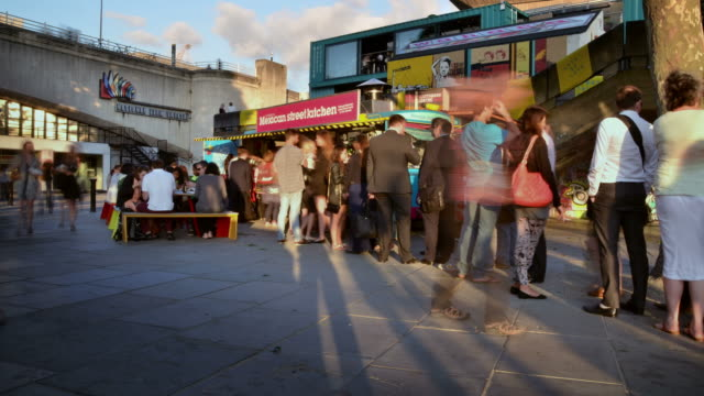 ms t/l shot of restaurant south bank early evening beside queen elizabeth hall street level tourists and office workers / london, greater london, united kingdom - queen elizabeth hall stock videos and b-roll footage