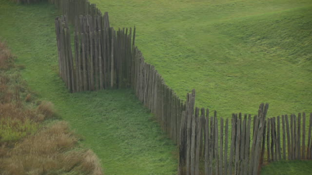 cu aerial zo shot of restored stockade wall to restored mound at aztalan state park in jefferson county / wisconsin, united states - state park stock videos & royalty-free footage