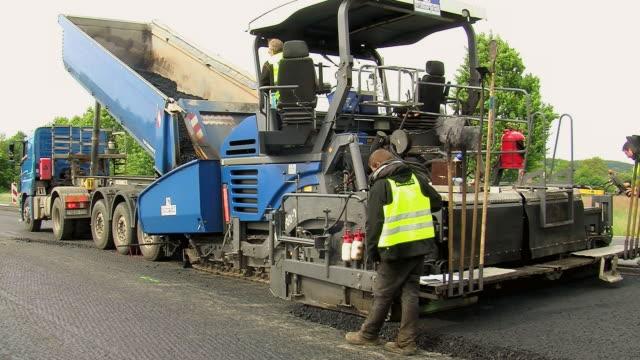 MS Shot of resurfacing of road / Saarburg, Rhineland-Palatinate, Germany
