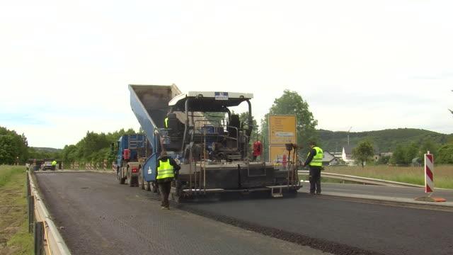 WS Shot of resurfacing of road / Saarburg, Rhineland-Palatinate, Germany