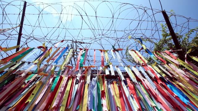 ms shot of reunited (south and north korea) wish tag in imjingak (near border of north korea) / paju, gyeonggi-do, south korea - 韓国文化点の映像素材/bロール