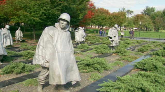ms pan shot of right past all soldier statues at korean war veterans memorial / washington, district of columbia, united states - male likeness stock videos & royalty-free footage