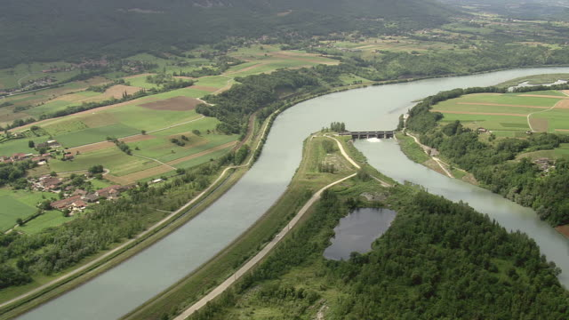 MS AERIAL Shot of river and farms / Rhone Alpes, France