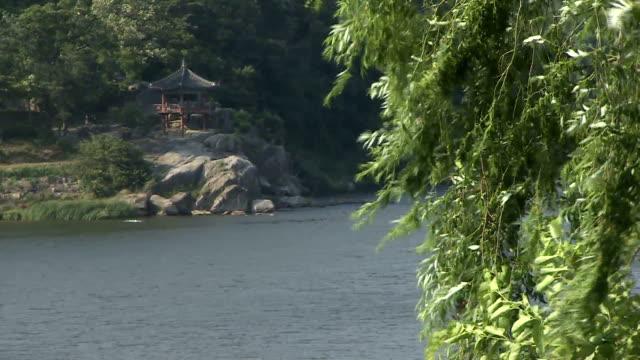 stockvideo's en b-roll-footage met shot of river and palgakjeong gazebo - gazebo