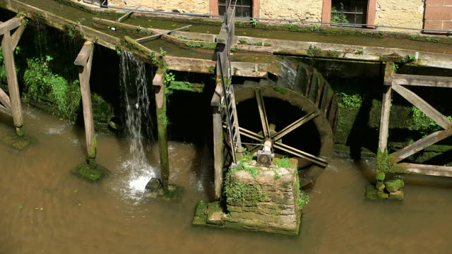 cu shot of river leuk with mill wheel / saarburg, rhineland palatinate, germany - mill stock videos & royalty-free footage