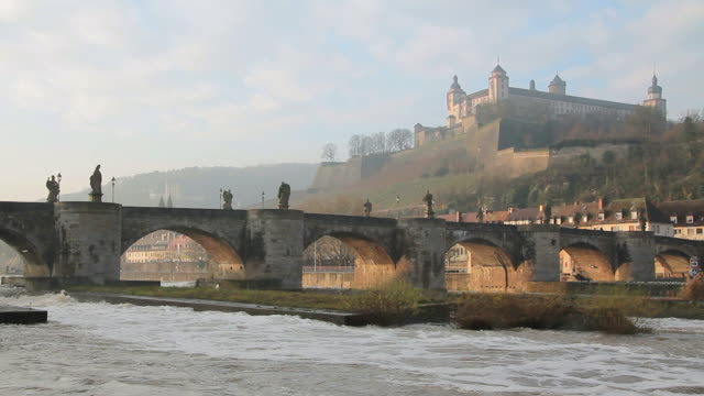ws shot of river, old bridge and marienberg fortress / wurzburg, bavaria, germany - wurzburg stock videos and b-roll footage