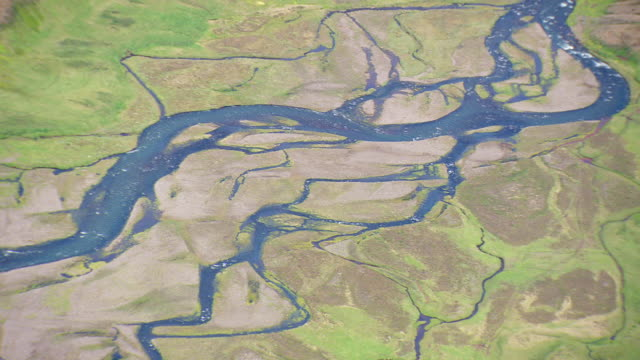 ms aerial shot of river patterns / iceland - natural pattern stock videos & royalty-free footage