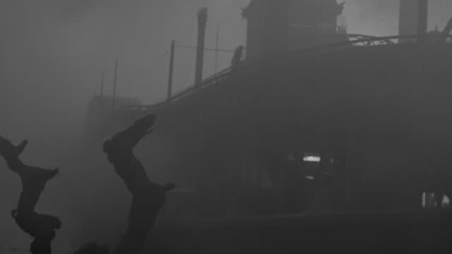 MS LA Shot of riverboat on river in fog (miniature)
