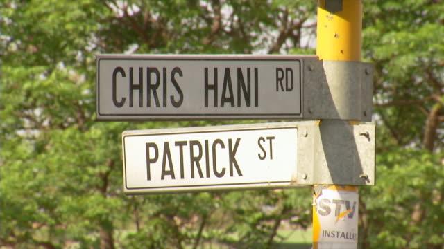 cu shot of road sign indicating chris hani road and patrick street / soweto, gauteng, south africa - ソウェト点の映像素材/bロール