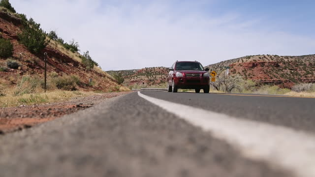 WS LA Shot of road with cars driving past / Santa Fe, New Mexico, United States