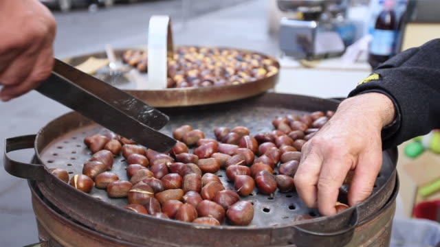CU Shot of roasted Chestnuts for sale / Rome, Italy