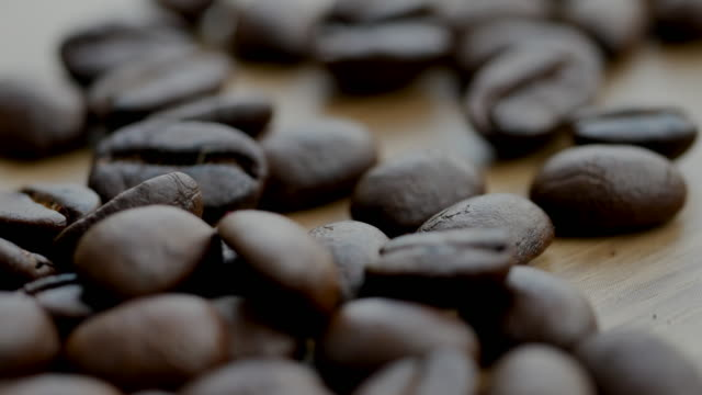 shot of  roasted coffee bean on the floor - frothy drink stock videos & royalty-free footage