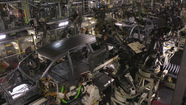 MS Shot of Robot welders fabricating mini van bodies in auto assembly plant / Princeton, Indiana, United States